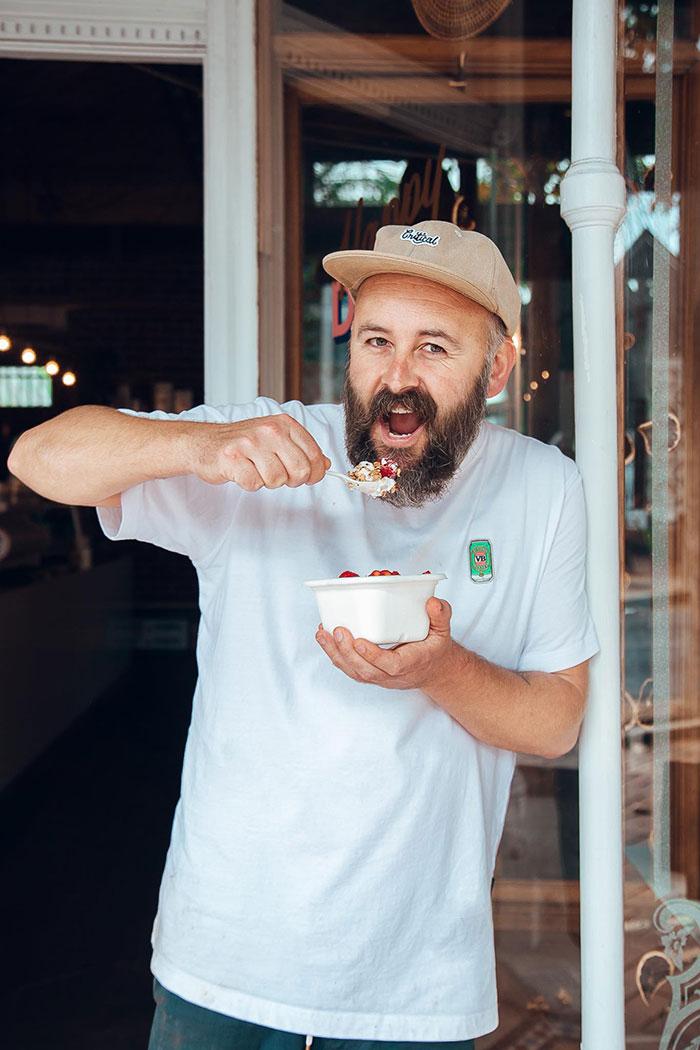 Benny with a takeaway bircher Muesli bowl on Crown st
